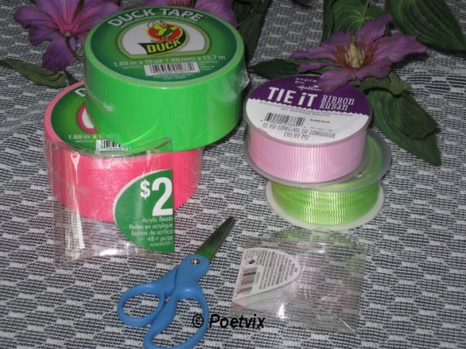 Materials - Scissors, duct tape, ribbon and plastic containers.