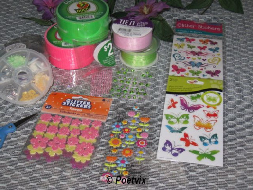 Here are some of the materials I thought to use to dress up the purse. I ended up using the glitter foam cut outs and the peel and stick rhinestones.