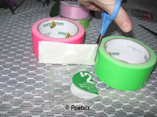 Begin by taping the bottom first. Cut the tape so you have enough to fold it over on the sides.