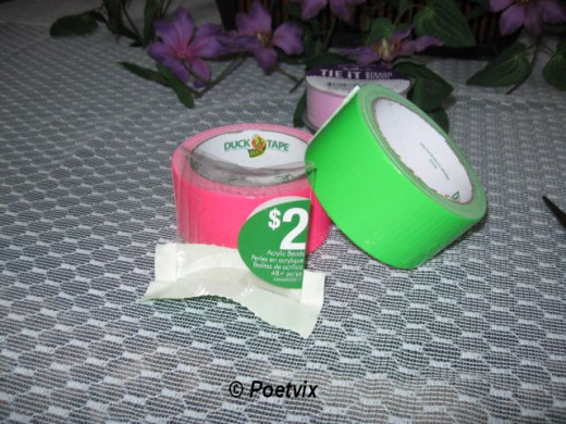 Lay the container lightly over the sticky side of the tape and use your finger to smooth it down.