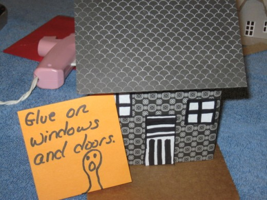 Small rectangles cut out and colored with a marker make quick windows and doors.