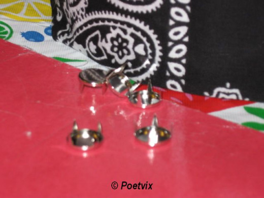 I used simple silver studs to secure the fabric under the drawstring so it would not fall down and to add some bling. These are super easy. You just push it through the fabric and then use your finger to press the prongs down and secure it. I suggest