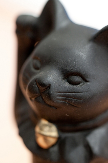 A Maneki-neko with right paw raised is thought to bring good luck.