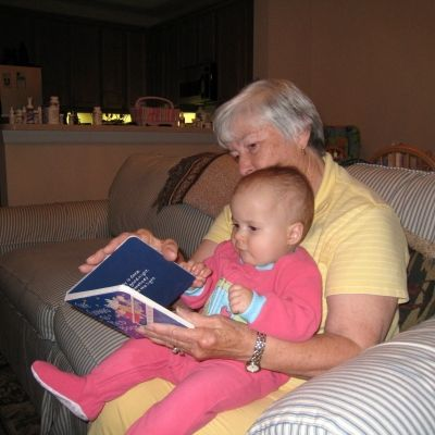 My daughter at 8 months reading with her grandma.  It's never too early to start reading to your children or grandchildren.
