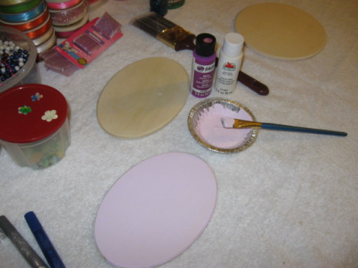 Paint plaques. I mixed a dark purple with a lot of white here to get this lavender that seems to photograph pink.