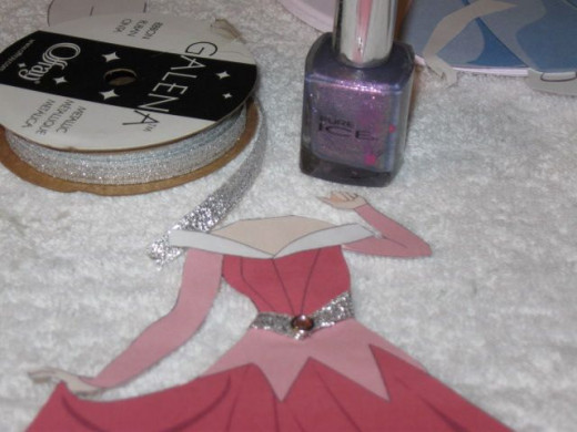 Her collar is purple glitter nail polish.