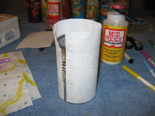 I had some of the Pringles cans show through after the Mod Podge, so use plain white paper first to prevent any little spots showing.