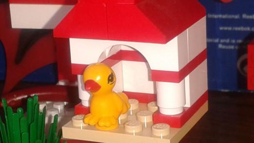 Lego Bird in a birdhouse.