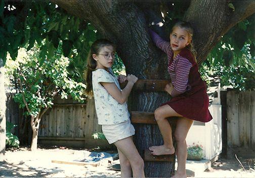 My nieces climbing a tree.