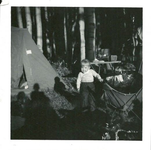 My sister Lynne in front of the tent.  We started camping young in my family.