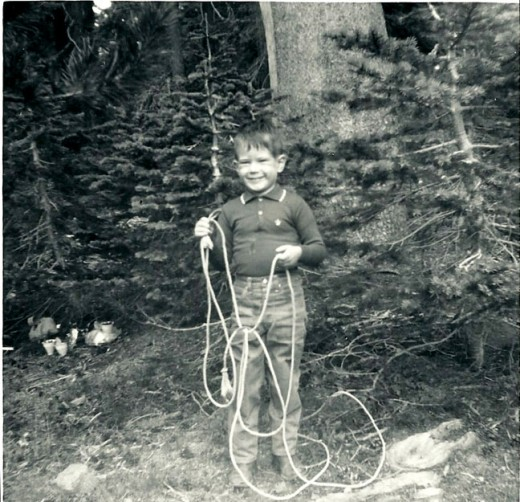 My brother Scotty, learning to rope a tree.  Hard work.