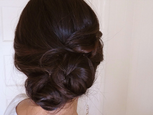 This lovely hairdo has been created by making 2 fishtail braids and twisting them into a chignon updo.