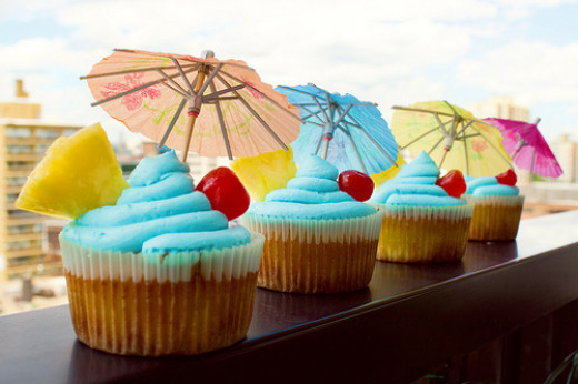 That's a vanilla, coconut & rum cupcake with pineapple jelly inside and a bright blue Curaçao buttercream icing on top!