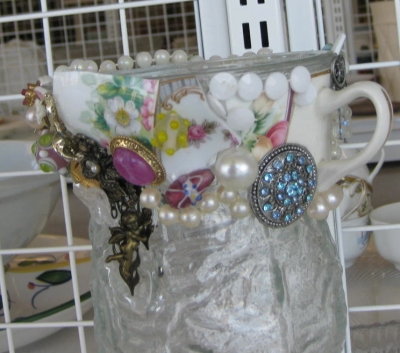 Costume Jewelry and Mosaic China on a Glass Vase