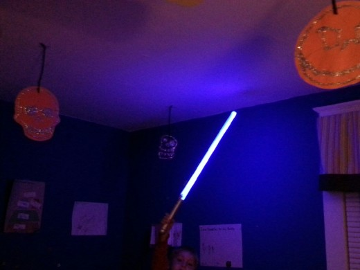 My son lighting his up with a lightsaber.