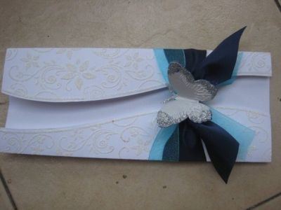 See the butterfly?  I cut it with cuttlebug die cutter and emboss it with cuttlebug embossing folder