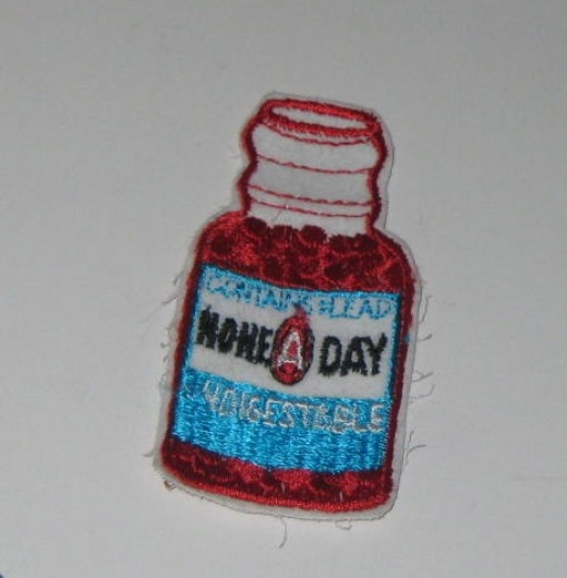 None A Day Contains Lead (One A Day Vitamins) Sew On Patch.