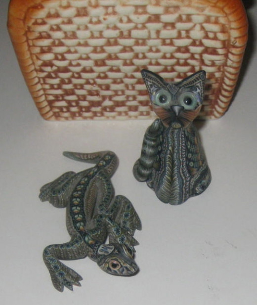 Two polymer clay wonders, works of art really:  a lizard and a bug-eyed cat.