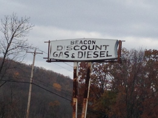 Ghost sign on freestanding sign, Berkeley Spring, West Virginia. Photo Credit:  Lori Burdoo