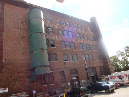 Ghost signs on old factory looking building.