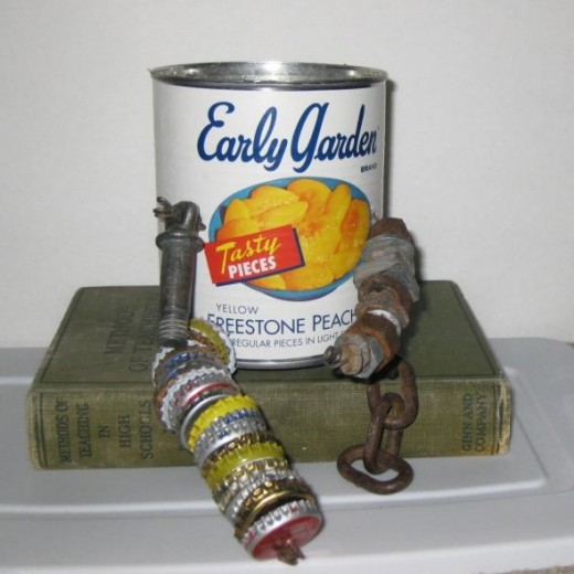 This peach can that makes up this tin can man's body was opened with a smooth edge can opener.