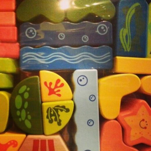 "A colorful set of wooden ""under the sea"" blocks by Swiss toy makers, Hape.  Features happy octopus, bubbles, sea grass, sand, waves, starfish, & more."