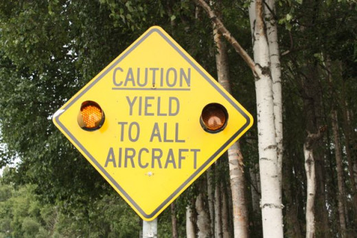 """Caution, Yield to All Aircraft"" This road sign made me laugh!"