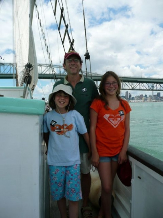 Hubby and our girls seem to be enjoying the cruise as the Auckland Harbour Bridge looms in the background.