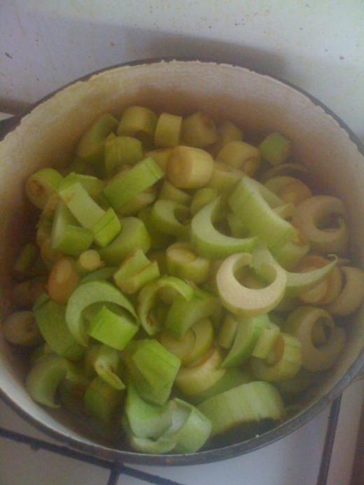 Add the chopped taro stalks.