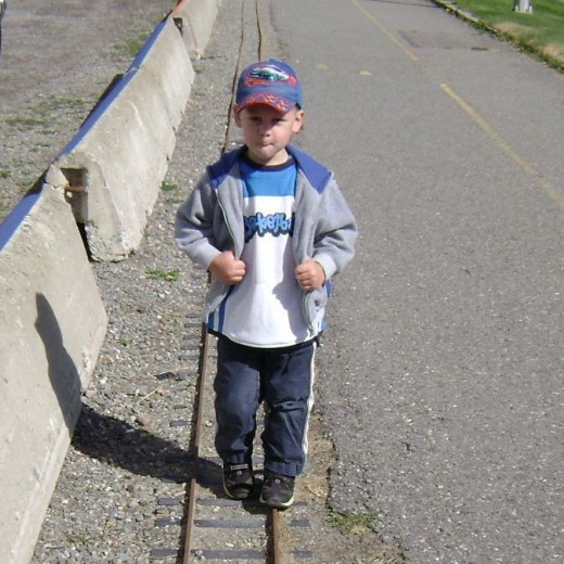 Marching along a miniature train track at the Cranbrook Rail Museum