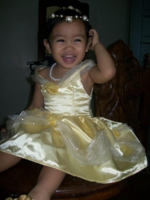 Happy with her princess look. We were just at home but after watching Sofia the First, she wanted to wear her gown.