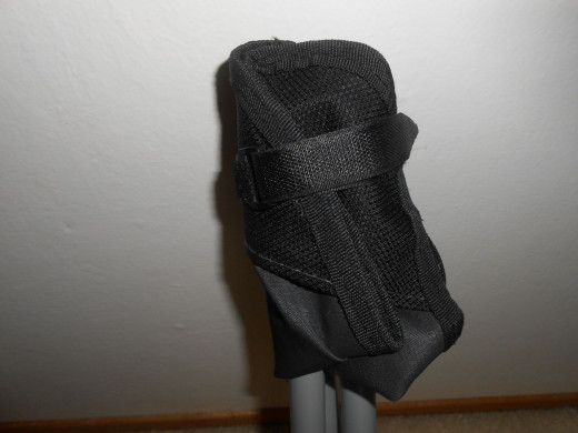 A velcro strap around seat keeps the chair legs secure for carrying.