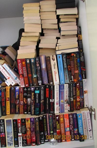 Just a few of the books I have at home that I can't part with