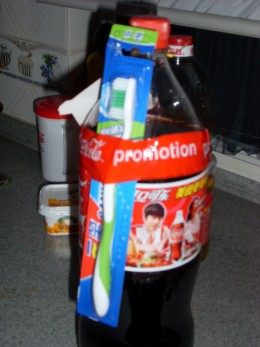 A bottle of coke with a toothbrush as a free gift.