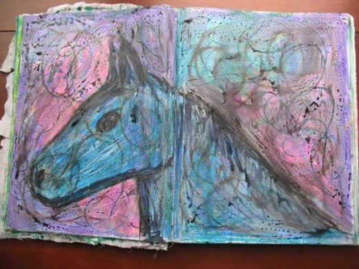 The horse with Inktense blocks and paint worked over the top.