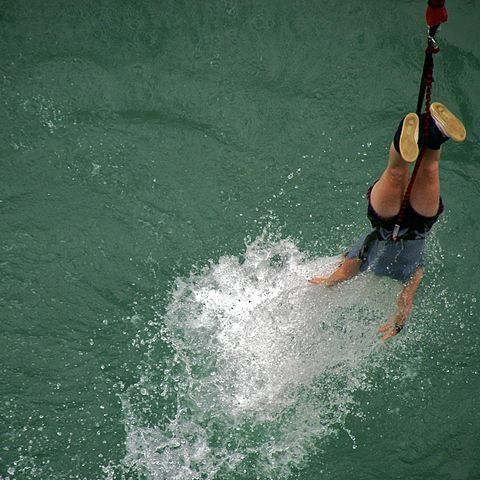 Taking a dip whilst bungee jumping