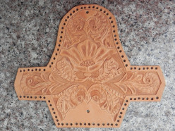 Leathercrafting a hand carved leather coin purse.