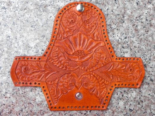 The carved leather gusset coin purse after the dyeing stage.