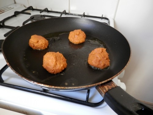 Shallow frying the shrimp balls in some olive oil.