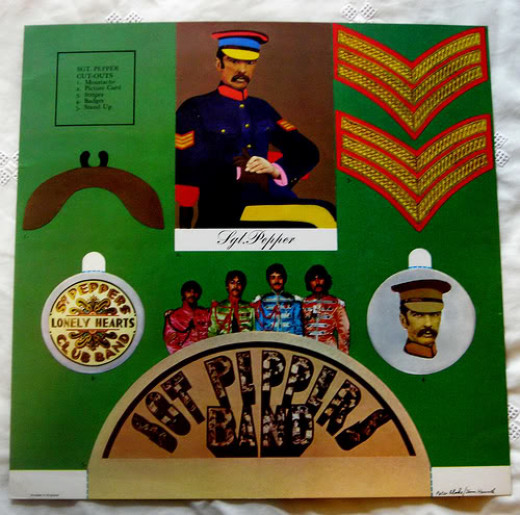 Sgt. Pepper's Lonely Hearts Club Band by the Beatles - showing Ringo Starr, John Lennon, Paul McCartney and George Harrison and Sgt Pepper himself