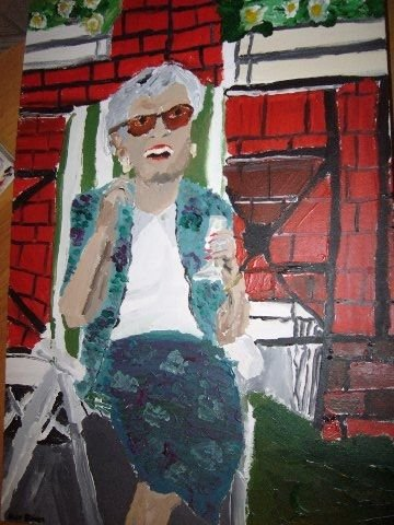 Here's my mother, sitting outside, enjoying herself in the sunshine with a gin and tonic! The painting is by her Grandson