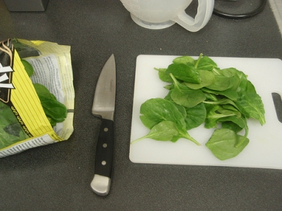 Preparing the spinach to make the sauteed spinach recipe
