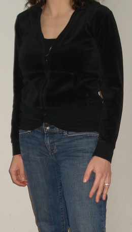 Wearing dark colored clothing on the top half of the body works to minimize the appearance of large breasts.