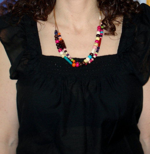 A 16-18 inch necklace can bring lead the eye up and away from noticing large breasts.