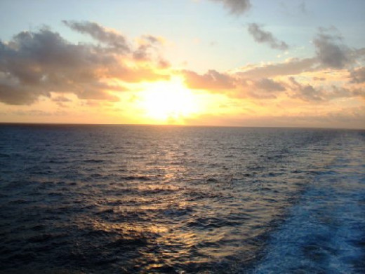 Photo of a sunset at sea, taken from our balcony on one of our recent cruises.