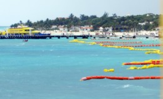 Floats allow swimmers and fisherman to share the same beach.
