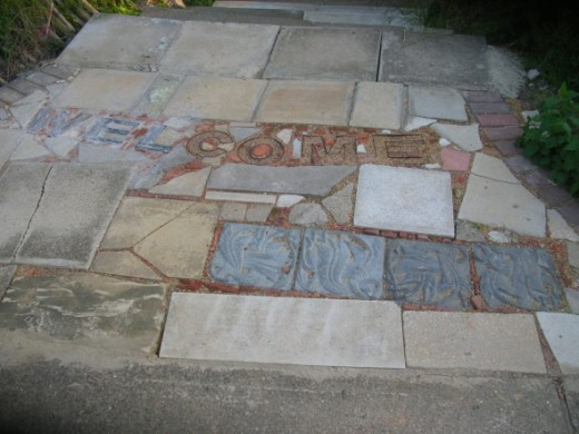 "The path way to the grotto features some specially made tiles and miniature crazy paving work which spells the word ""Welcome"" - something artists have always been on the Terrace!"