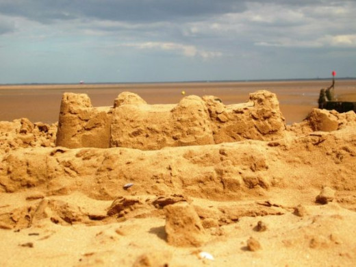 A crab's eye view of a sandcastle. Oh the happy hours spent making these! Not for us Brits the manicured and set sand sculptures over the Pond. Eternally the amateurs, we prefer our small scale work with bucket and spade.