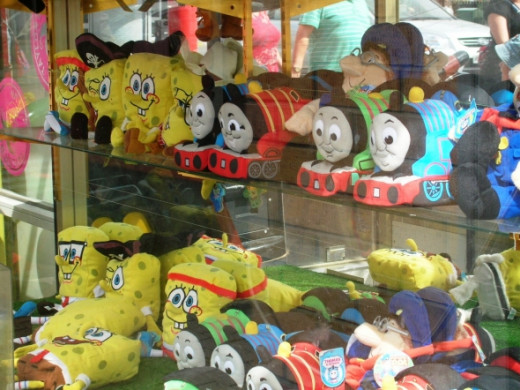 Thomas and Sponge Bob lure unsuspecting adults and eager children to the amusements...