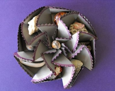 This paper rosette could easily hold candies for your guests at a table setting.